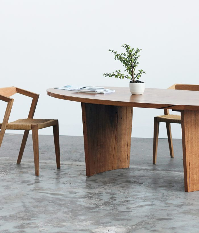 Oval timber dining table