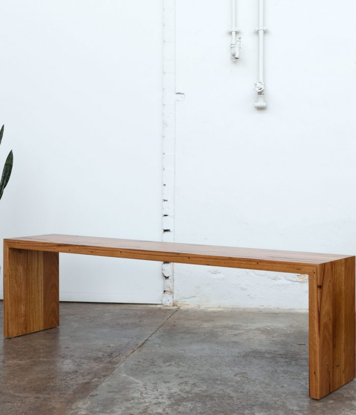 timber dining bench with snake plant