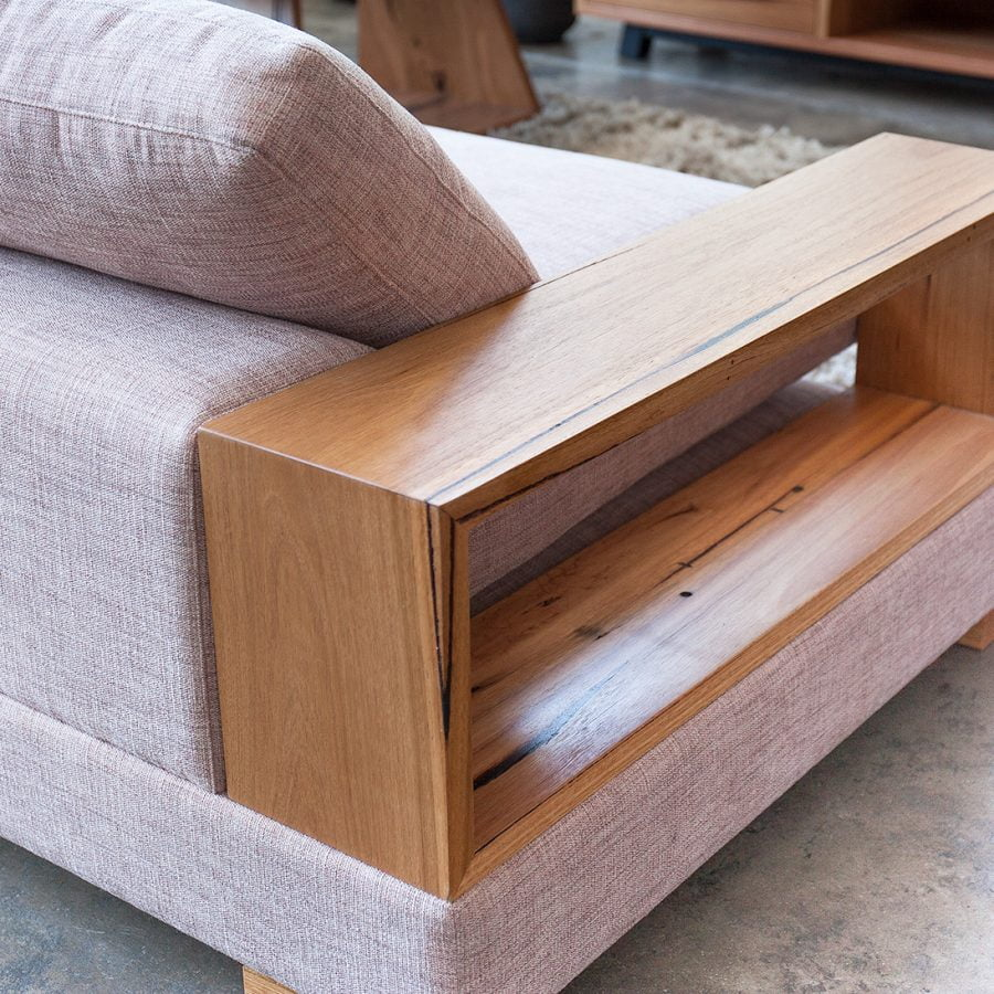 Three seater sofa with timber arm rest