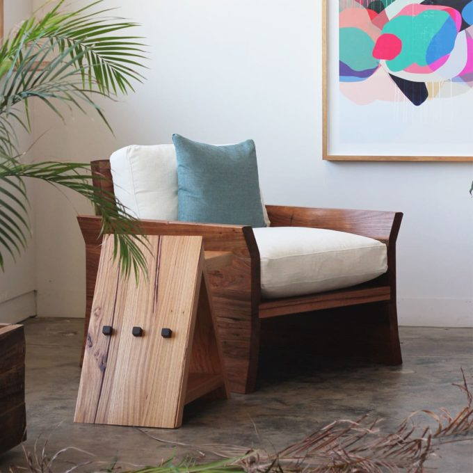 Timber armchair with palms and sidetable