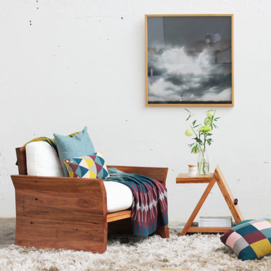 Side table with armchair with rug