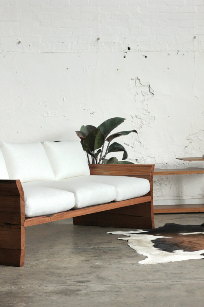 timber designer sofa with cushions