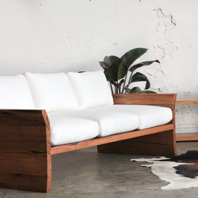 timber cream fabric sofa with plant