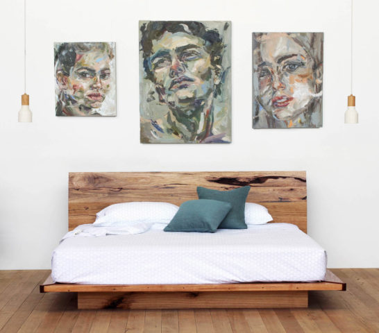 Timber platform bed with paintings