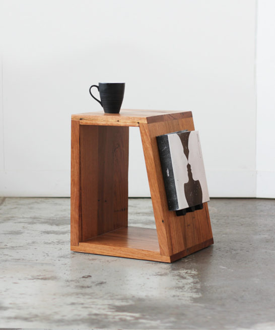Recycled timber side table with cup and book
