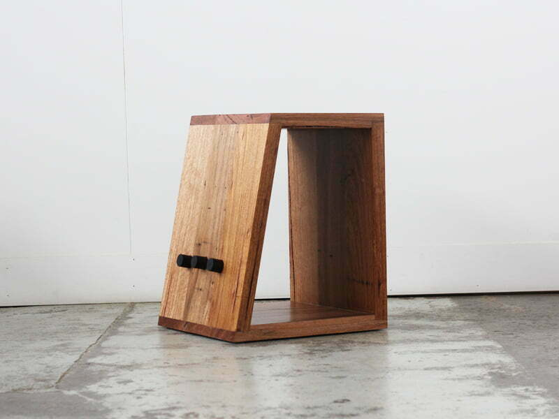 Recycled timber side table with detail to hold books