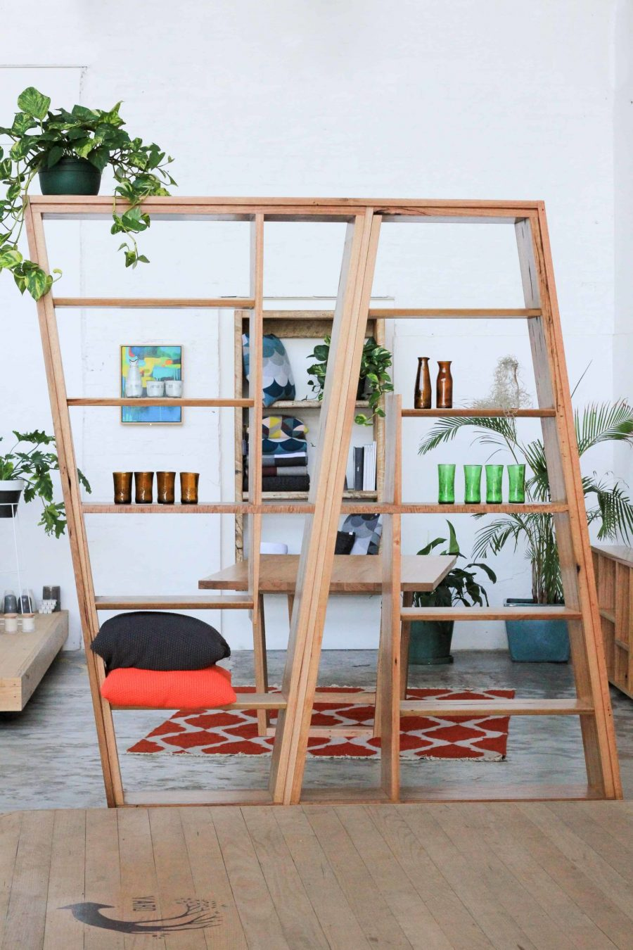 timber shelving unit and room divider