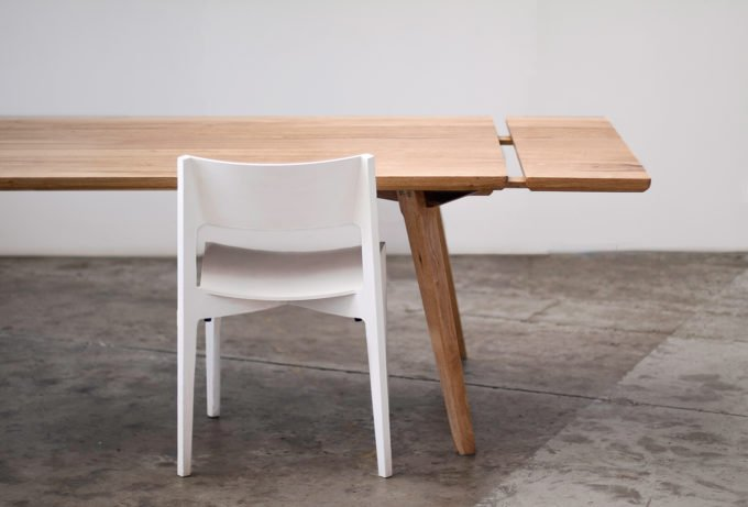 Timber extendable dining table with white chair