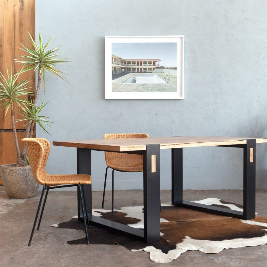 Timber dining table with black leg detail