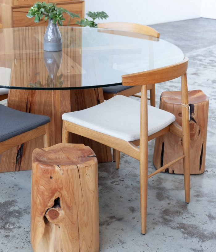 Glass timber table with chairs and stool