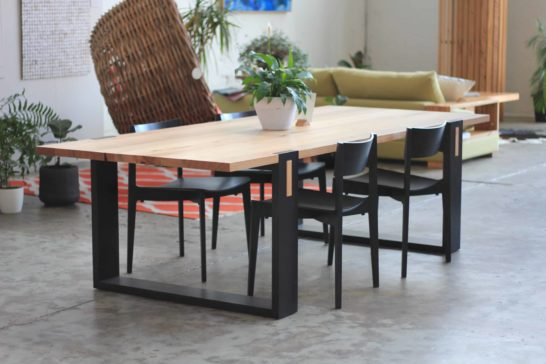 Timber dining table with black legs
