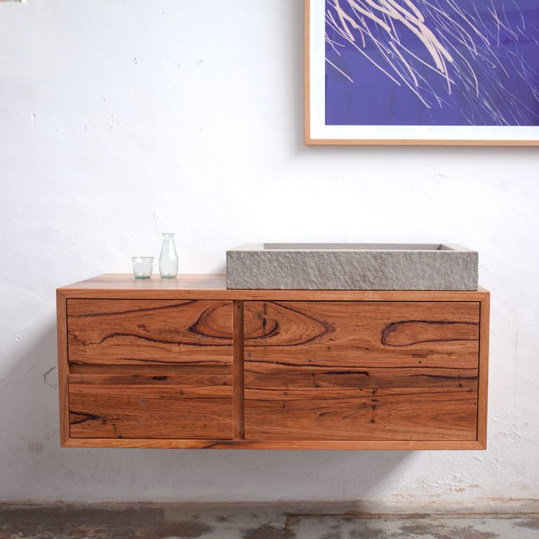 floating timber bathroom vanity with minimalist sink and painting