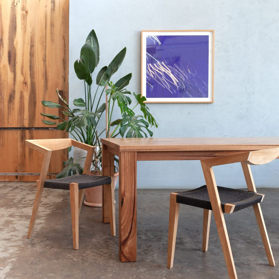 timber dining table with woven chairs