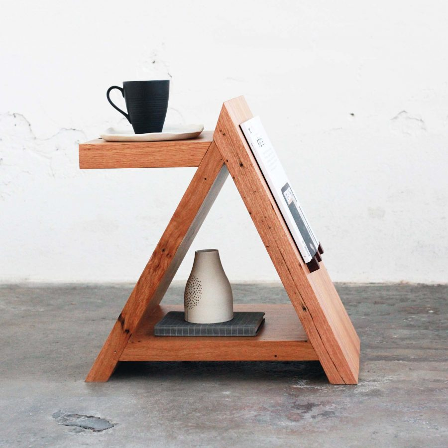 Timber side table with coffee cup and magazine
