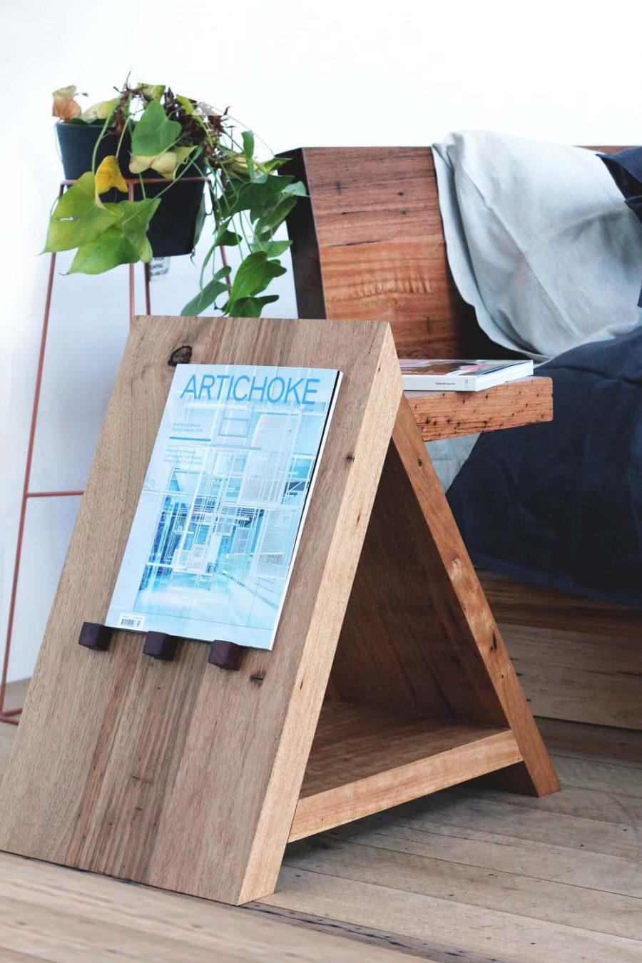Timber side table with plant