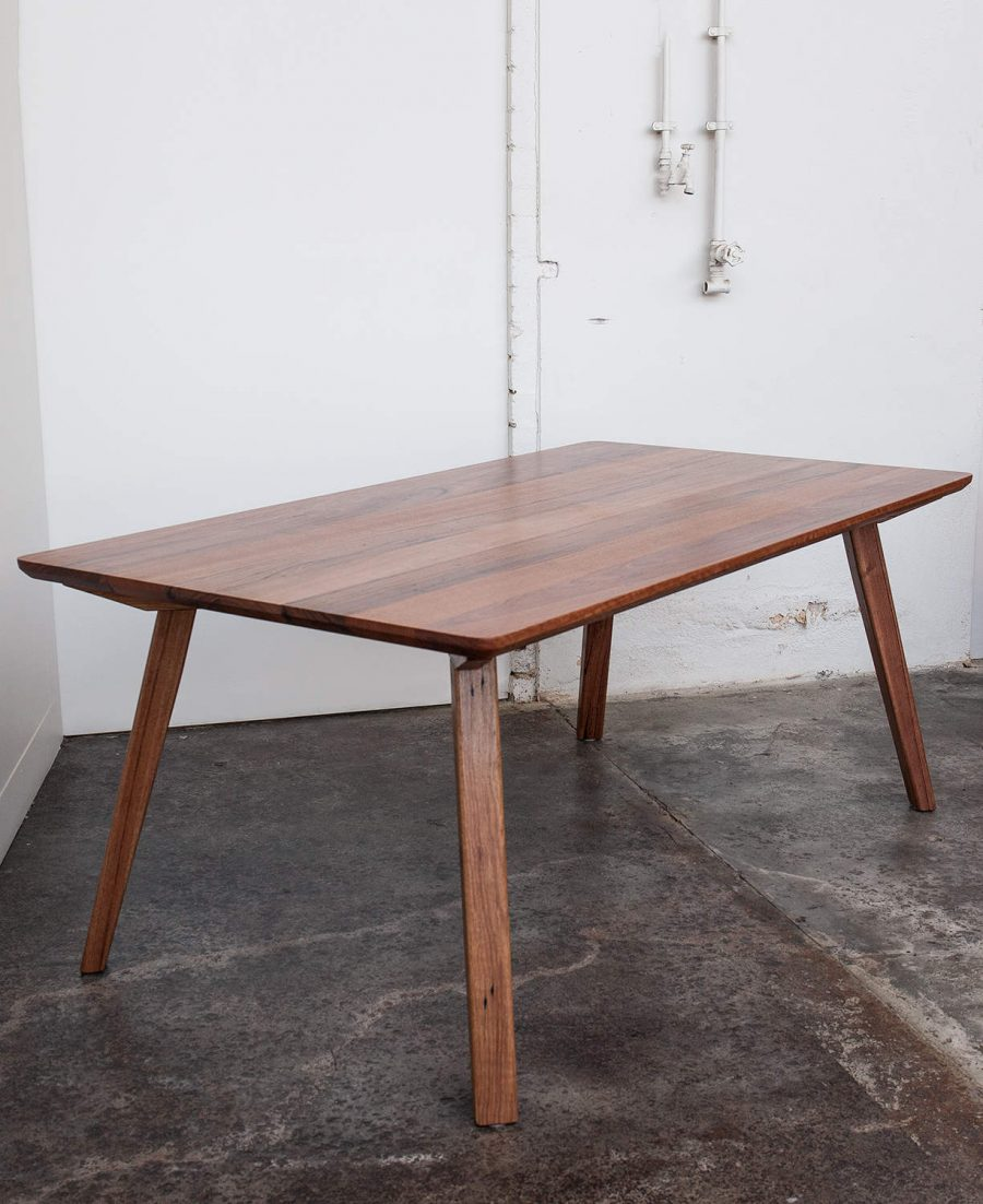 Recycled dining table with white wall