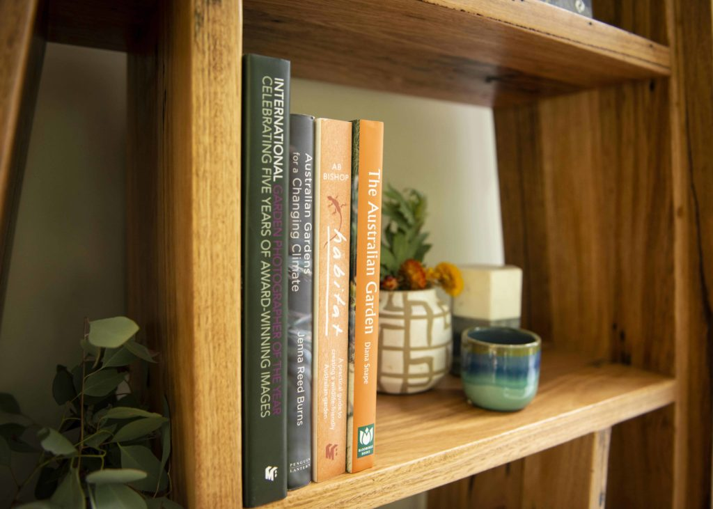 timber bookshelf with books