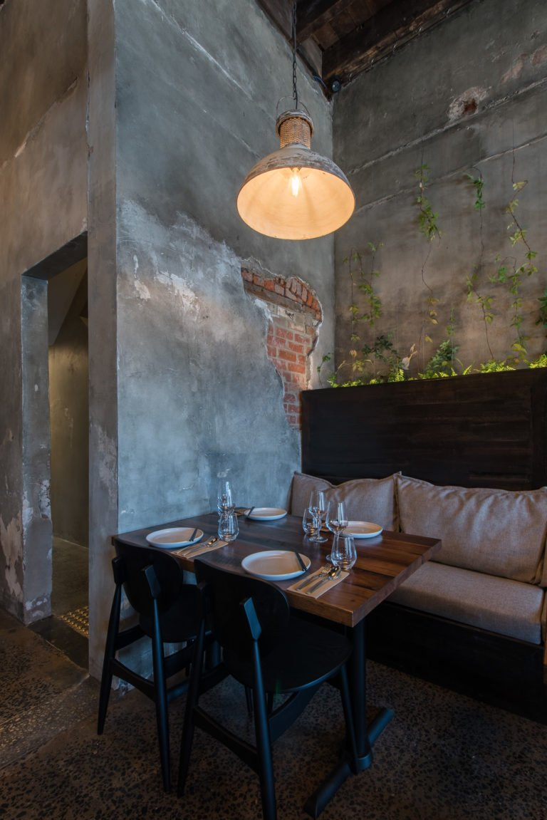 custom restaurant furniture against exposed brick walls