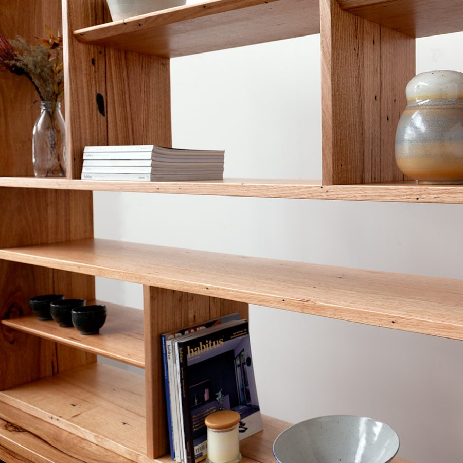 Wall unit shelf with books