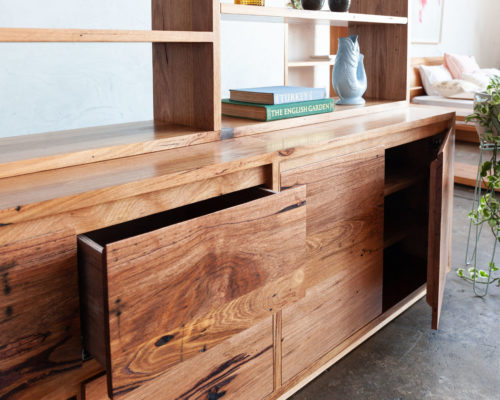 recycled timber wall unit bookshelf with books and plants