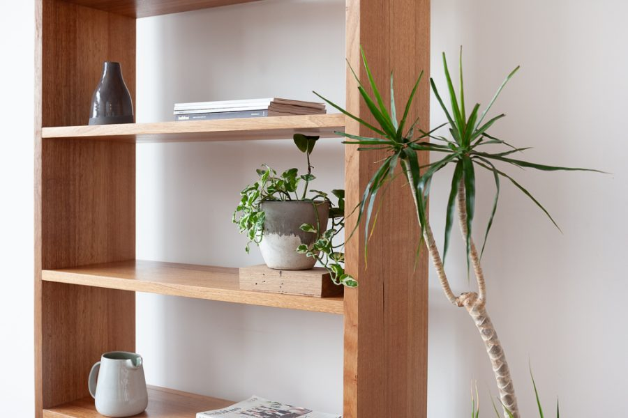timber bookshelf with plant