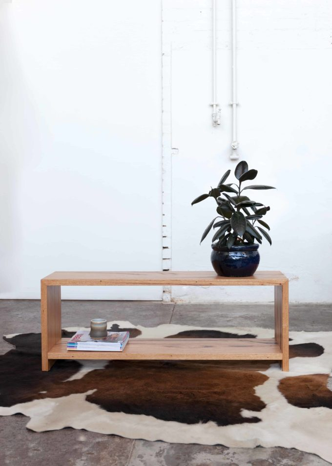 timber coffee table with plant