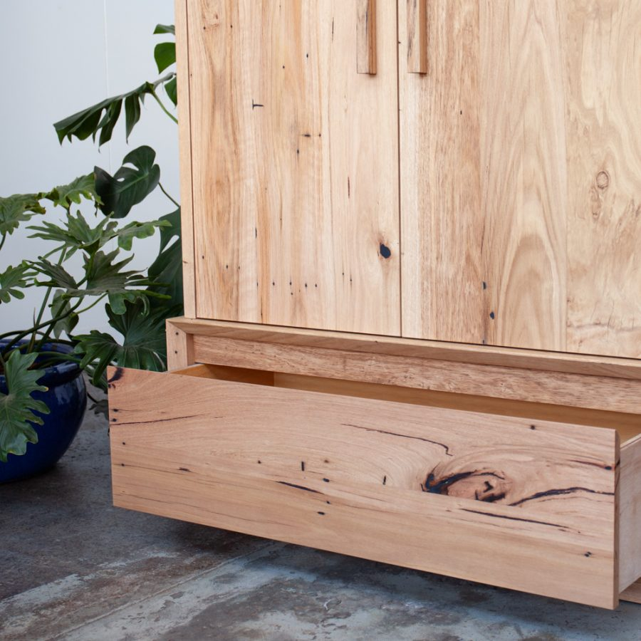 timber wardrobe with plant