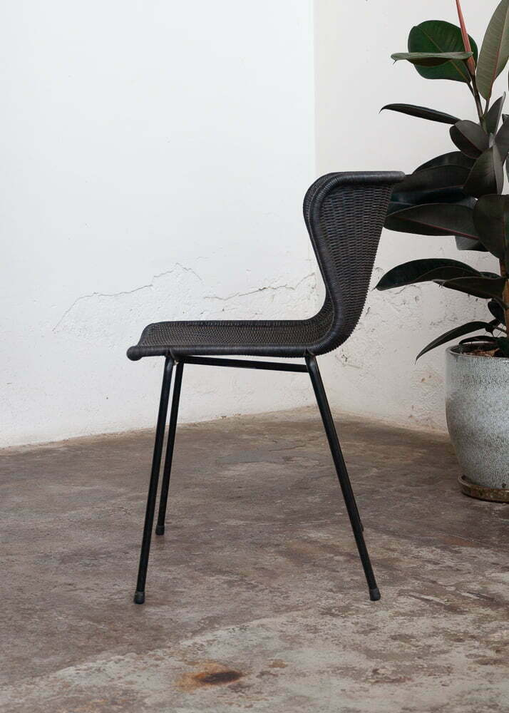 rattan dining chair with rubber plant