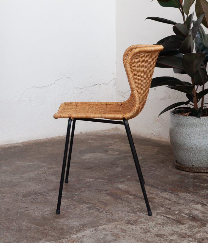 rattan dining chair with plant