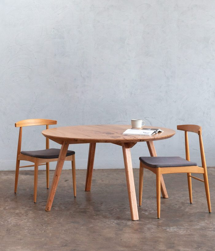 round timber dining table with chairs