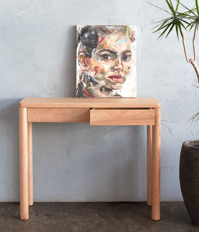 timber hall table with plant